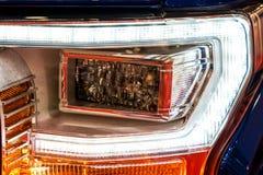 Головные света автомобиля спорт стоковое изображение