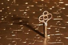 головоломка золотистого ключа к Стоковые Фото