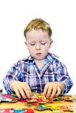 головоломка мальчика Стоковое Изображение
