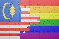 Головоломка с национальным флагом Малайзии и гомосексуалист сигнализируют Стоковое фото RF