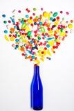 Голубая бутылка с красочным взрывом конфеты Стоковое Изображение