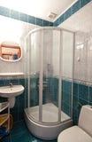 Голубая ванная комната темы стоковые фото