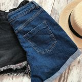 Голубая джинсовая ткань замыкает накоротко назад стоковое фото