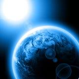 Голубая земля планеты с солнцем Стоковые Фотографии RF