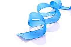 Голубая изолированная тесемка тканья Стоковое Фото
