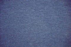 Голубая и серая текстура ткани Голубая и серая предпосылка ткани Закройте вверх по взгляду голубых и серых текстуры и предпосылки Стоковое фото RF