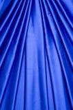 голубая сатинировка картины занавеса Стоковая Фотография
