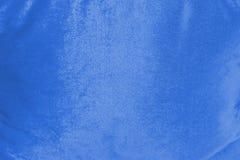 Голубая сияющая предпосылка текстуры бархата стоковая фотография rf