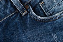 голубая текстура джинсыов джинсовой ткани заднее карманн джинсыов предпосылки Стоковые Изображения