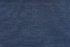 голубая темная текстура джинсыов Предпосылка ткани джинсовой ткани Стоковое Изображение RF