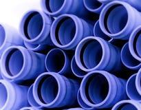 голубая труба полива Стоковые Изображения