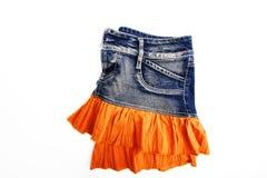 Голубая юбка джинсовой ткани на белой предпосылке Стоковое Фото