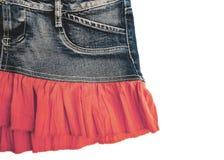 Голубая юбка джинсовой ткани на белой предпосылке Стоковые Фото