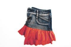 Голубая юбка джинсовой ткани на белой предпосылке Стоковая Фотография