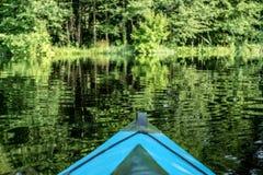 Голубое каное на реке Стоковое фото RF