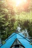 Голубое каное на реке Стоковая Фотография