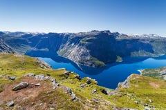 Голубое озеро в Норвегии около Trolltunga Стоковые Фотографии RF