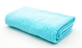 Голубое полотенце на белизне Стоковые Фотографии RF