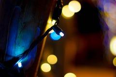 Голубое Chritsmas освещает вверх близко стоковое фото
