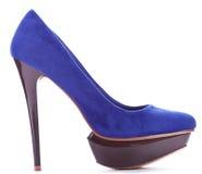 Голубой высокий накрененный ботинок женщины стоковое изображение rf