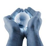 голубой глобус вручает зиму Стоковая Фотография RF