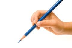 голубой карандаш удерживания руки Стоковые Изображения