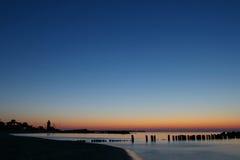 голубой померанцовый ровный заход солнца Стоковые Изображения RF