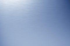 голубой почищенный щеткой металл Стоковое Фото