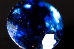 Голубой самоцвет на черной предпосылке Стоковые Изображения RF