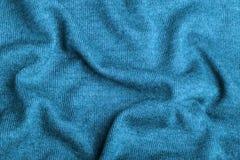 Голубой связанный конец текстуры ткани вверх Смогите быть использовано как предпосылка Селективный фокус стоковая фотография