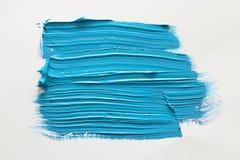Голубой ход щетки акварели над белой предпосылкой стоковое фото rf