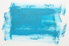 Голубой ход щетки акварели над белой предпосылкой Стоковая Фотография