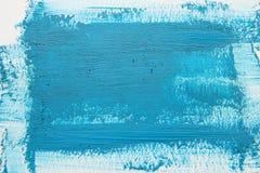 Голубой ход щетки акварели над белой предпосылкой стоковое фото