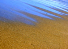 голубой электрический блеск песка стоковые изображения rf