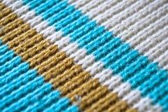 Голубые белые и бежевые вязать шерсти, предпосылки текстуры стоковая фотография