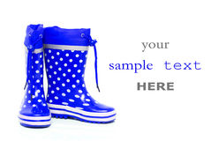 голубые ботинки резиновые стоковое изображение