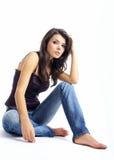 голубые джинсыы девушки сексуальные стоковое фото