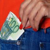 Голубые джинсы и 100 евро Стоковые Фотографии RF