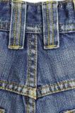 голубые джинсы предпосылки Стоковая Фотография