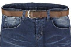 Голубые джинсы при кожаный пояс изолированный на белой предпосылке Стоковое фото RF