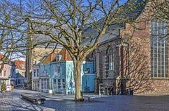 Голубые дома и церковь в топить стоковые изображения rf