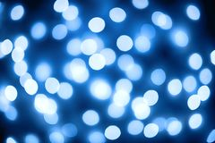 голубые круговые отражения Свет рождества и Нового Года Blured стоковое фото