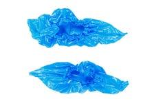 Голубые крышки ботинка на белой предпосылке Стоковые Фотографии RF