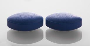 голубые пилюльки 2 стоковое изображение