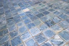Голубые плитки грубой поверхности текстурированные квадратные Стоковое фото RF