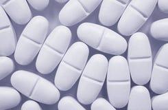 голубые светлые таблетки Стоковая Фотография