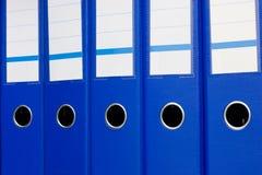 голубые скоросшиватели архива Стоковые Изображения RF