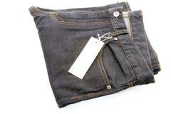 голубые темные джинсыы Стоковая Фотография