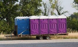 голубые pottys porta пурпуровые стоковые изображения