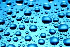 голубые waterdrops Стоковая Фотография